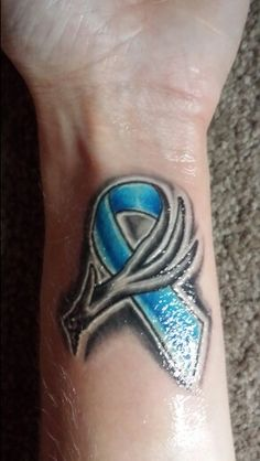 Prostate cancer ribbon with deer antler. For my dad...a prostate cancer fighter...♡ Courtesy of Kings and Queens Tattoo/Brad Benson...Monroe, MI #prostatecancer #tattoo
