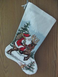 Ride Em Santa cross stitch stocking by UniqueChristmasbyAmy, $65.00