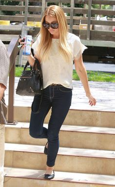 : Lauren paired her dark denim skinnies with a white lace top and basic black flats in LA.Lesson from Lauren: a few posh accessories elevate casual separates.