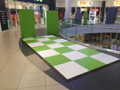 green & white painted floor for display in Tygervalley Mall