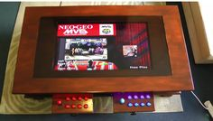 This unassuming coffee table transforms into a tabletop arcade machine with just a touch of a button.