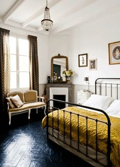 Some beautiful pieces in this Bordeaux townhouse. The curtains, yellow quilt and pendant light are particularly beautiful. Est Magazine.