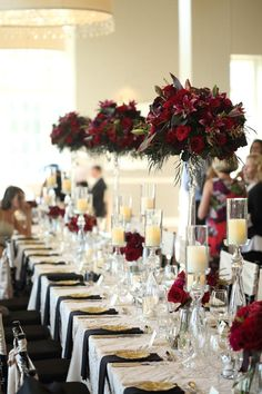 Romantic Red Wedding, Calhoun Beach Club, Minneapolis, MN - Linen Effects - www.lineneffects.com - Minnesota Party Rental Decor - Photography by Studio 306 - Dark red and burgundy floral on the head table with our Pressed Glass Risers, more glass risers with candles and black and champagne accent colors -- #Calhoun #Beach #Club