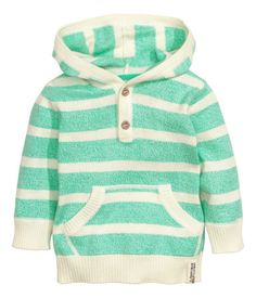 Hooded sweater in soft, fine-knit cotton fabric with a button placket, kangaroo pocket at front, and ribbing at cuffs and hem.