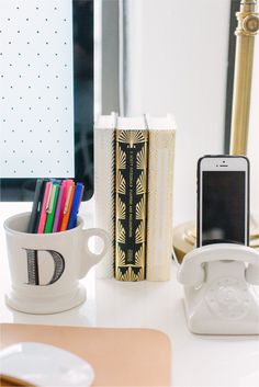 @Danielle Moss of The Everygirl // office space // white desk // gold lamp // @Anthropologie mug // @Jonathan Adler docking station // photography by Stoffer Photography