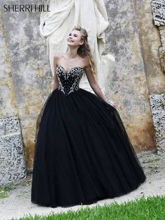 Corseted sweetheart ballgown, fit for a princess, is trimmed with rhinestones and pearlS