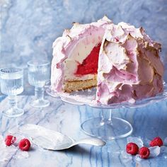 Fresh raspberries add amazing colour and flavour to the insulating meringue layer of this ice cream bombe recipe.