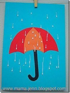 Umbrella with glue raindrops.  Preschool craft.