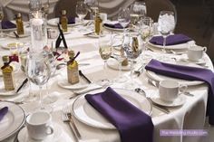 Purple napkins accent the table settings at the Belvedere Banquets in Elk Grove. Photographed by The Wedding Studio, Schaumburg IL