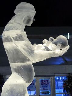 A 2m tall ice sculpture of Mary and Baby Jesus carved by Jamie Wardley from Sand  in your eye. It was carved live in the Halifax Piece Hall as part of their ice sculpture trail in 2009.