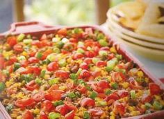 Nacho Grande Casserole---My mother-in-law taught me how to make this, we use Rotel, canned corn (drained), the Mexican cheese blend, and we either make with Doritos OR cornbread. Tre prefers the Doritos and I prefer the cornbread so we usually end up making it half and half. Delicious!