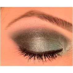 Black, green dramatic eye using Urban Decay, Mac and MUFE.