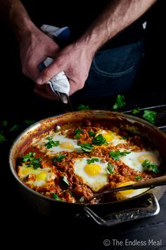 Shakshuka is a traditional Middle Eastern/North African egg and tomato breakfast skillet. Much of it can easily be made ahead of time for the perfect brunch