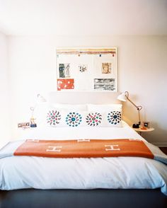 A neutral and orange bedroom