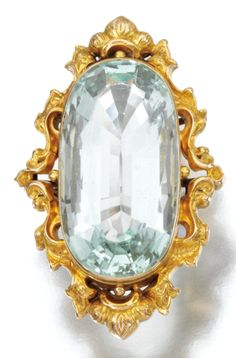 GOLD AND AQUAMARINE JEWEL, CIRCA 1840. Set to the centre with an oval aquamarine within a repoussé frame, later set as a ring.