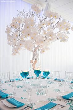 Tip of the Day: If you plan on having tall centerpieces, give your candles a chance to impress as well by floating them in water dyed to match your wedding colors. Just choose wide-footed vessels that are weighed down so that they don't tip over if someone bumps into the table.