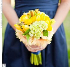 I like the feel of this bouquet alot. The only things I would change would be to remove the pale orange daisies.