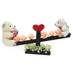 Make her heart seesaw with happiness and love with an out of box gift that she will cherish forever. Get her a beautiful love memento of 12 x 6 inch wooden seesaw decorated with artificial flowers carrying 2.5 inch and 2 inch teddy bears. Express your deep feeling of your heart of staying with her through thick and thin of life. Ideal gifting option for any occasion. http://www.fnp.com/valentine/