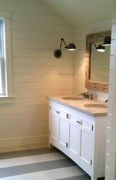 Floor tile, wood walls, sconce