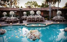 Does your venue have a pool? Include the water surface in your floral budget to include unique pool centerpieces.