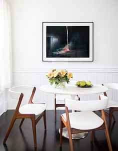 ~fresh flowers, plates of citrus, pops of color for this white beauty. Love~ (Julia Leach's victorian-era home)