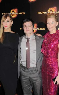 Jennifer Lawrence, Josh Hutcherson, and Elizabeth Banks at the Paris premiere of The Hunger Games today at Cinéma Gaumont Champs-Elysées Marignan. Josh looks like he's trying to make himself look taller lol