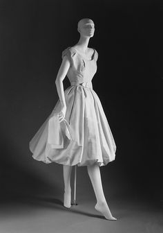 """""""Muguet""""  House of Dior (French, founded 1947)  Designer: Christian Dior (French, Granville 1905–1957 Montecatini) Date: spring/summer 1954 Culture: French Medium: (a, b) silk (c) leather.  Credit Line: Gift of Mrs. Byron C. Foy, 1955.  I LOVE the bubble effect, it makes the dress WAY CUTE!!!"""