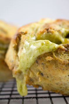 Herby Cheese Pinwheel Scones - Packed with mixed herbs, basil pesto and stuffed with cheese that melts into every crevice! These pinwheel scones are AMAZING!! @almondtozest