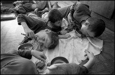 BELARUS. 1997. Novinki Asylum, Minsk. The boys on the floor. The boys are fed on the floor.  Paul Fusco/Magnum Photos