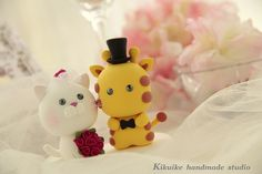 Wedding Cake Topper-love giraffe & cat by charles fukuyama, via Flickr