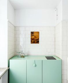 lovely tiny kitchen. white subway tiles, mint cupboars