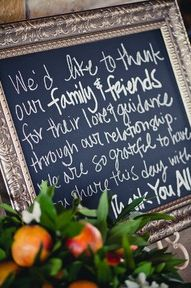 using framed blackboards with messages, memorial dates or sayings...placed on aisles, sitting on tables or hanging with command hangers...good way to brighten a white room