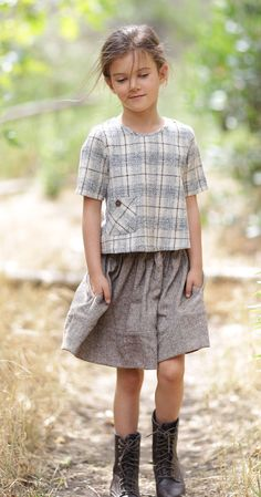 The Annie C. skirt is so charming and perfect for any autumn look. This heavy tan tweed is perfectly paired with the seasonal hue of your choice and made with a snug waist band, this skirt will surely