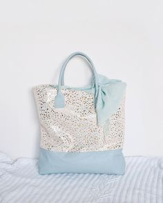 One of a kind leather tote bag made from beautiful blue & white leathers.
