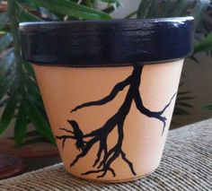 Check out this item in my Etsy shop https://www.etsy.com/listing/225771966/hand-painted-terracotta-pot-with-bird