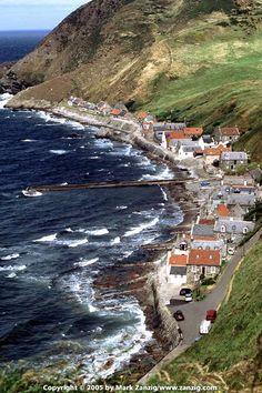 I feel chilly just looking at those whitecaps.  Village of Crovie, Scotland.