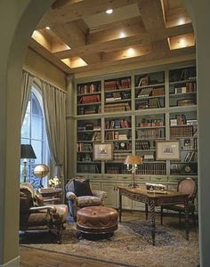 I like the set-up, not necessarily the decor - but including a wall of books, a comfy chair or two and a desk and ottoman