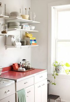 Simple kitchen: a simple white kitchen with red countertops