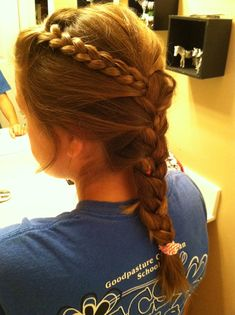 This is cute and messy. Great for sporty updos Step 1 take a section of hair and braid it Step 2 start a low French braid at the nape of the neck Step 3 enjoy