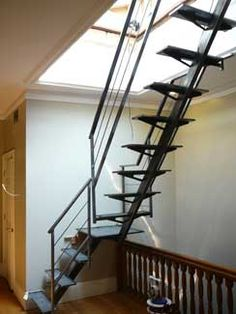 Interior Brownstone access stairs to hatch onto roof deck