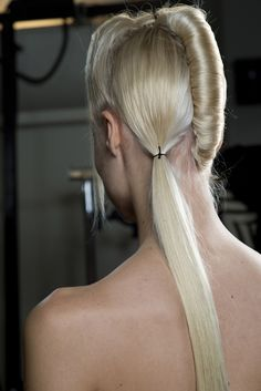 Back of the hair look for Haider Ackermann #SS14: a sharp ponytail on one side for an ultra feminine touch, 40's pleat on the other for sophistication. #pfw