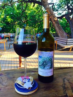 Enjoying a bottle of Cabernet Sauvignon Reserve under the towering oaks at the Salt Lick in Driftwood. Good times call for good wine!! | Becker Vineyards | Texas Wine