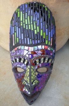 Striking Stained Glass Mosaic Mask Wall Art via Etsy