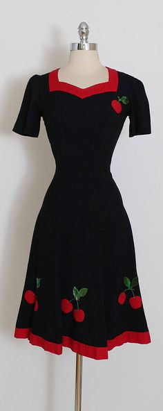 ➳ vintage 1940s dress * darling black woven cotton * velvet cherry appliques * metal side zipper condition | excellent fits like s/m length 41 bodice length 17 bust 36 waist 28 hips up to 40 ➳ shop http://www.etsy.com/shop/millstreetvintage?ref=si_shop ➳ shop policies http://www.etsy.com/shop/millstreetvintage/policy twitter | MillStVintage facebook | millstreetvintage instagram | millstreetvintage 5939/1715