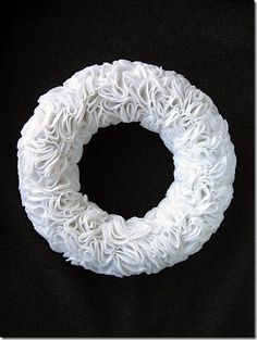 Felt wreath. use accent colors to spice it up, of keep it plain, and add card stock wording to dress it up for the seasons and holidays.