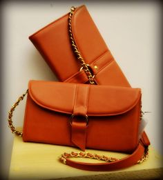 #busta #bustabags #leatherbag #leather #handmade #orange #metalstrap #metalchain