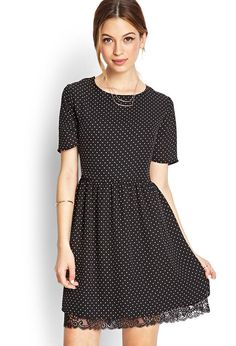 This polka dot print dress features a scalloped lace hem and round neckline. Complete with short ...