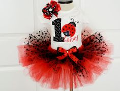 ****** Price is for shirt and tutu . Hair bow and diaper bloomer are sold separately . Please note your ladybug outfit is now RE-DESIGNED AS  the