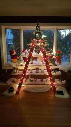 This homemade Christmas village ladder display looks beautiful.