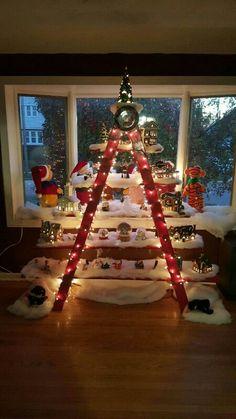 This homemade Christmas village ladder display looks beautiful.